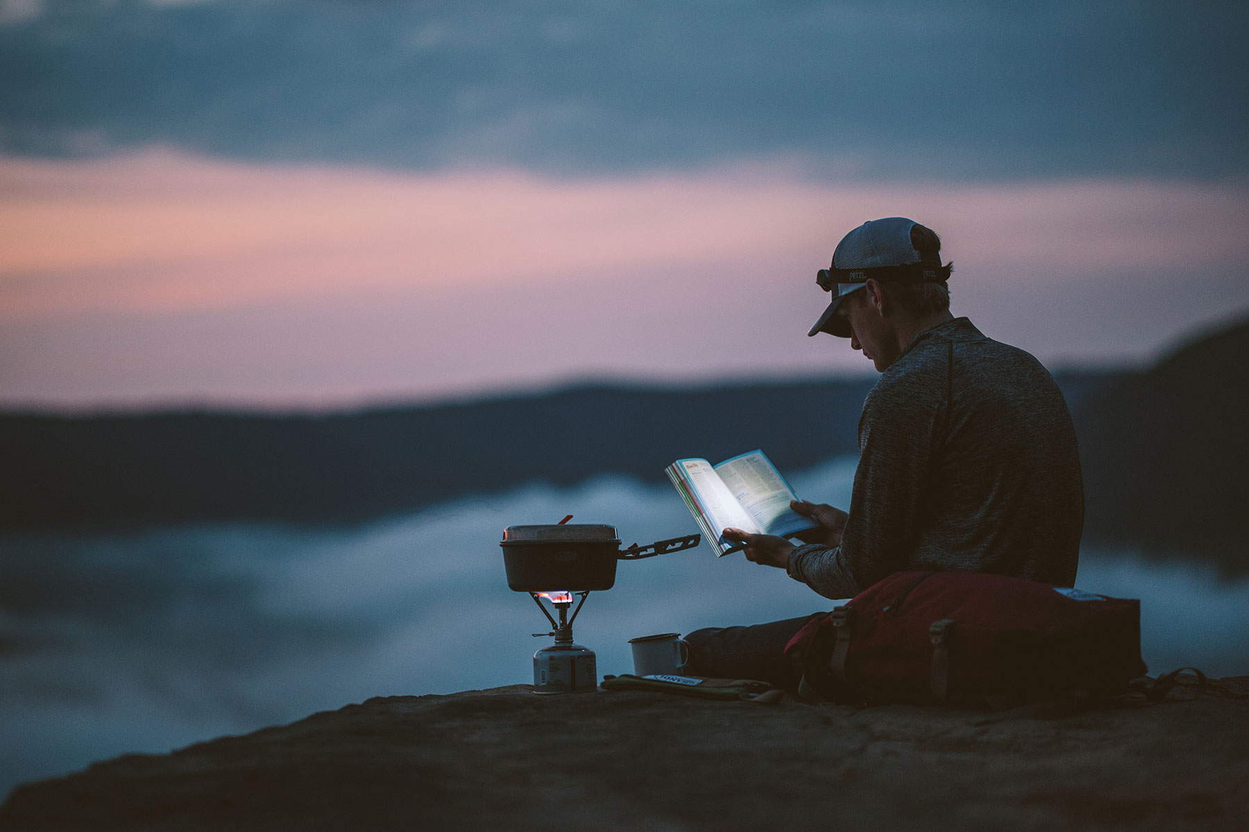 Person reading & camping