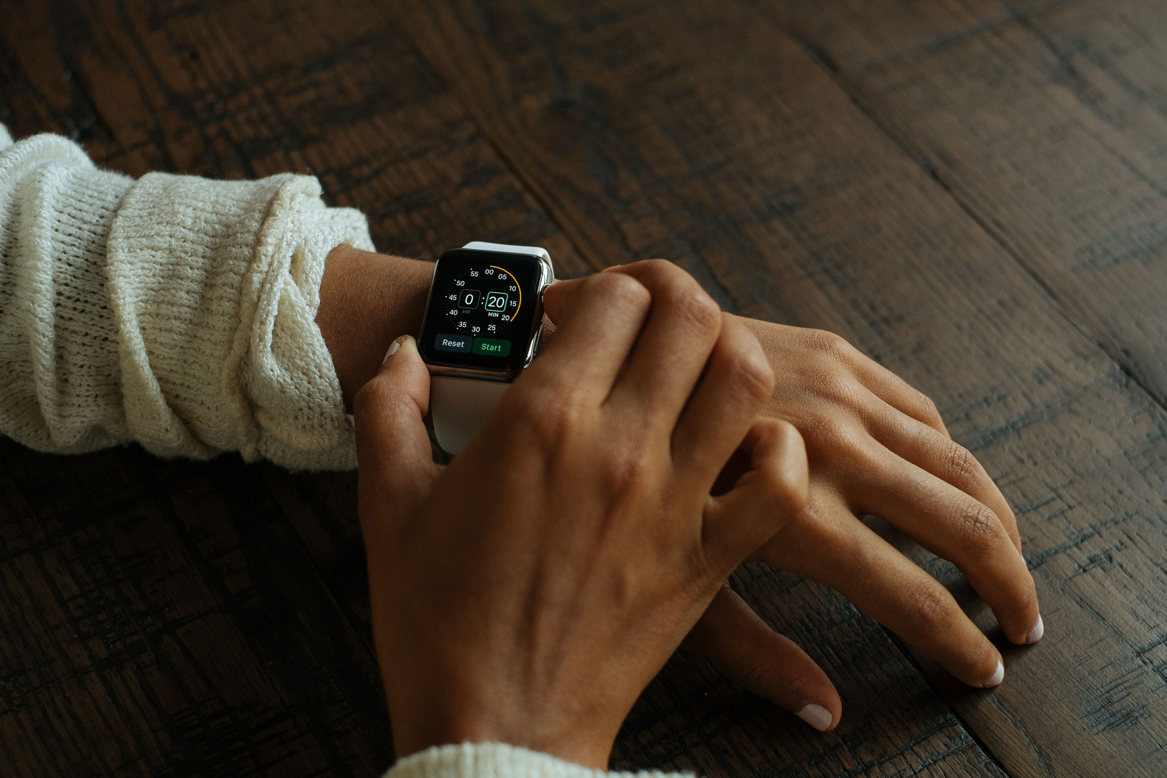 Woman using her Apple Watch
