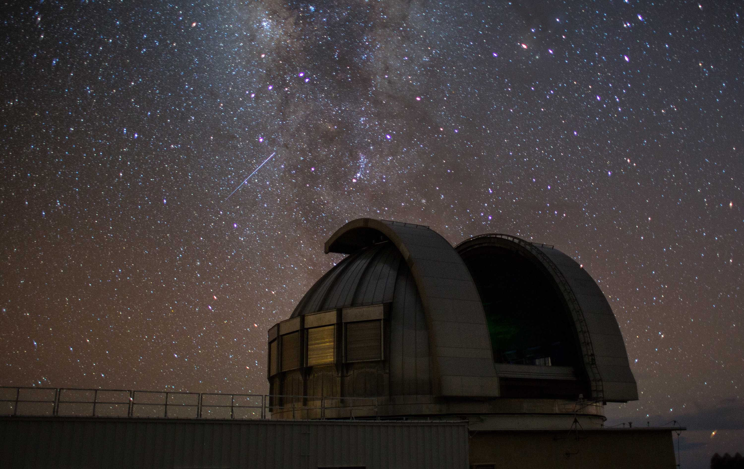 An observatory at night with stars