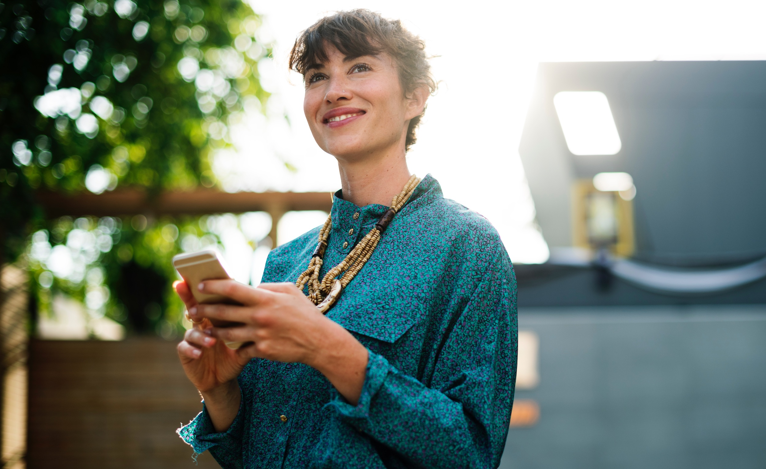 Smiling woman using her mobile